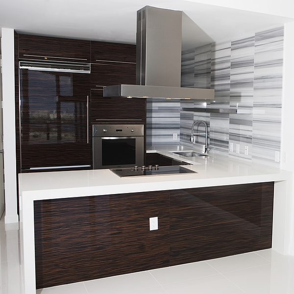 Vent, stove and countertop in empty modern kitchen Photograph by Camilo Morales