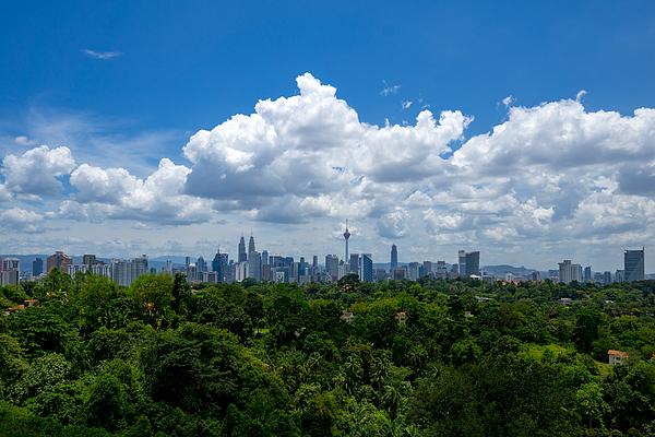 View Of Cityscape Against Cloudy Sky Photograph by Shaifulzamri Masri / EyeEm