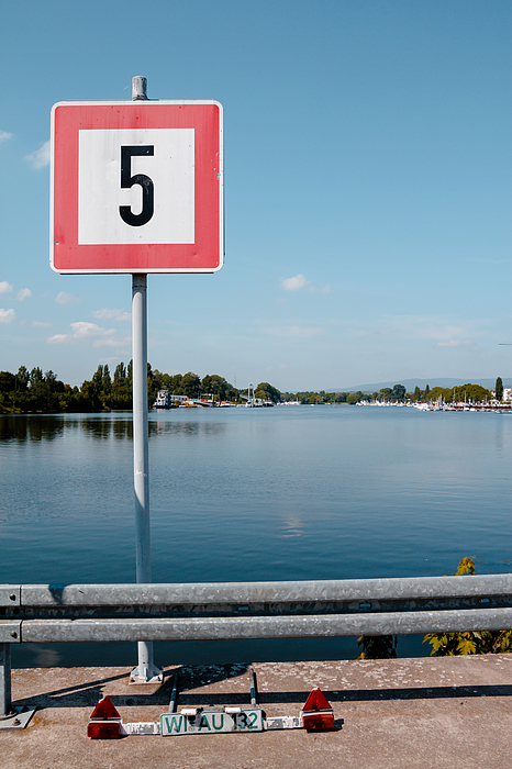 View Of Number On Sign Board Against Cloudy Sky Photograph by Albrecht Schlotter / EyeEm