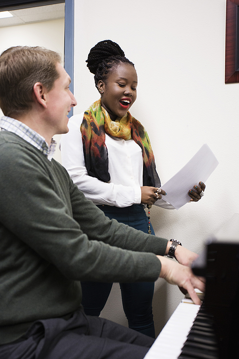 Vocal teacher and student singing at piano Photograph by Hill Street Studios