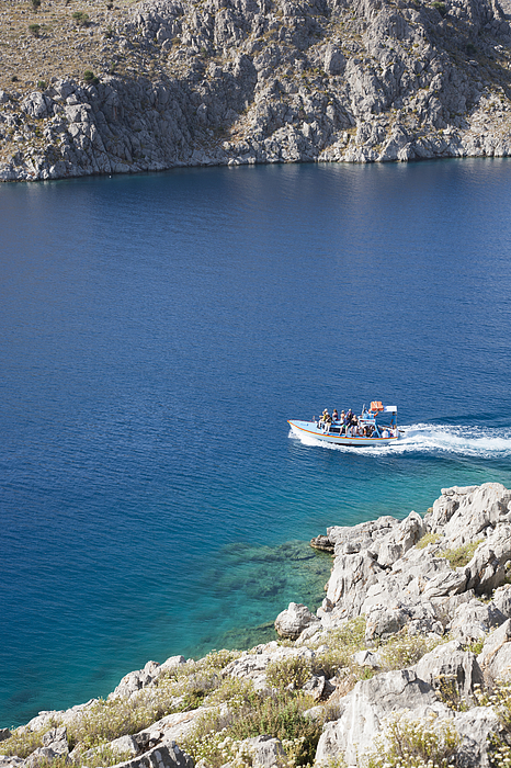 Water taxi crossing Pedi Bay, Pedi, Symi, Greece Photograph by David C Tomlinson