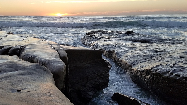 Waves on rocks at sunset Photograph by Shabnam Mozafari / FOAP
