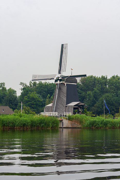 Windmill De Eenhoorn in Haarlem, the Netherlands Photograph by Flottmynd
