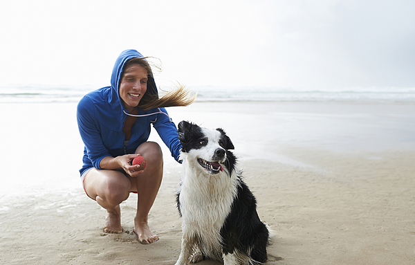 Woman And Dog On Beach. Photograph by Dougal Waters