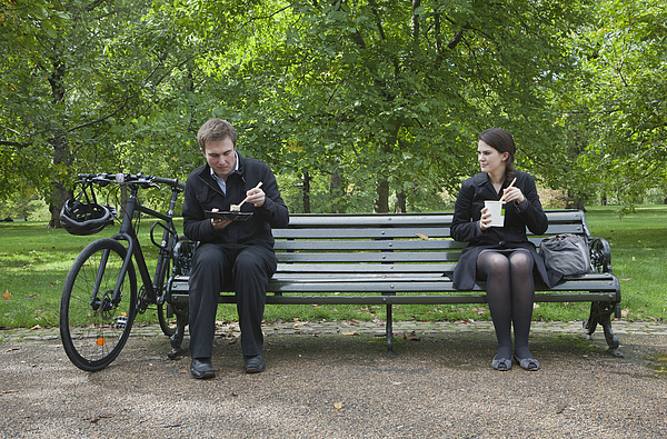 Woman And Man Eating Lunch On Park Bench Photograph by Clarissa Leahy