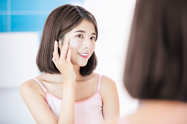 Woman Apply Cream On Face Photograph by RyanKing999