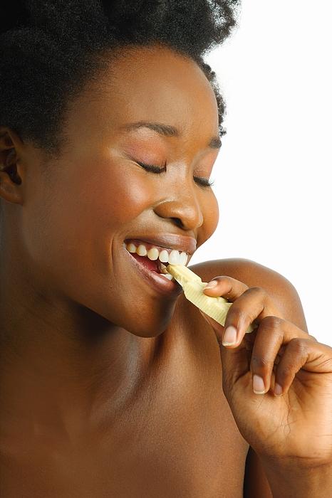 Woman Eating White Chocolate Photograph by H Rautenbach