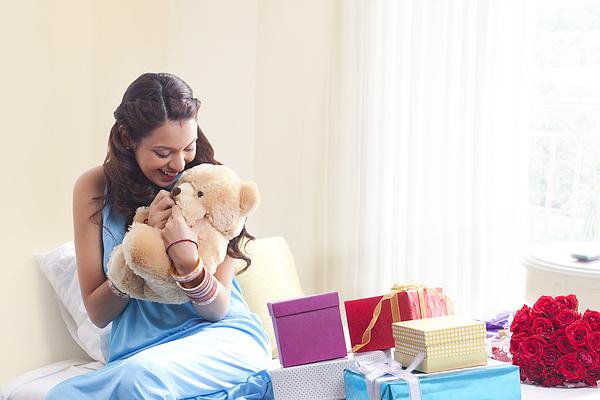 Woman holding a teddy bear Photograph by Hemant Mehta
