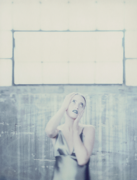 Woman Holding Head Photograph by Matthieu Spohn