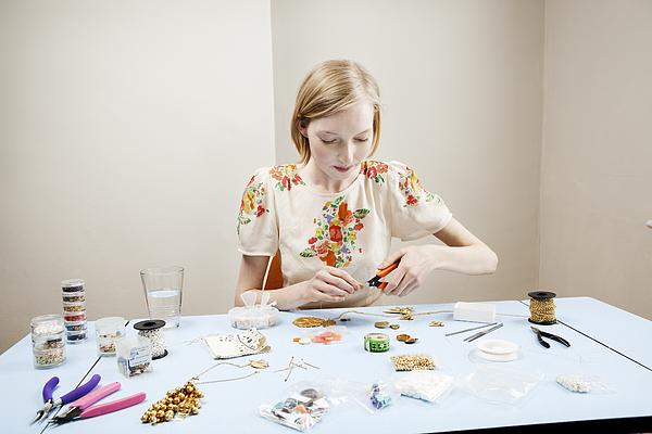 Woman Is Making Jewellery. Photograph by Betsie Van der Meer