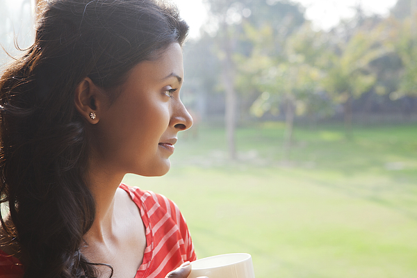 Woman looking out of window Photograph by Ravi Ranjan