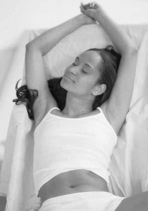 Woman Lying Down Stretching Arms Up, B&w. Photograph by John Dowland