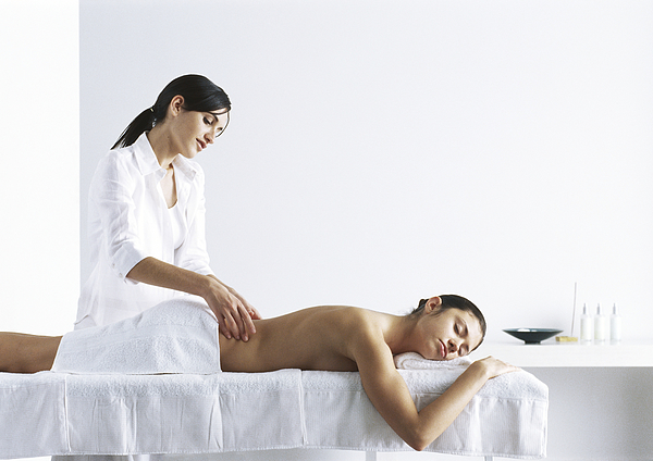 Woman Massaging Second Woman On Massage Table Photograph by Frederic Cirou