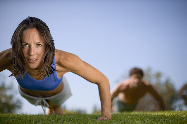 Woman performing push up in park Photograph by Joe McBride