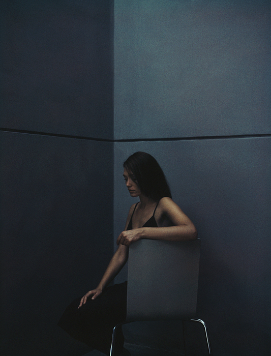Woman Sitting In A Corner. Photograph by Matthieu Spohn