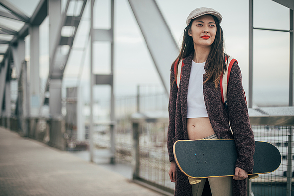 Woman Skater Outdoors Photograph by South_agency