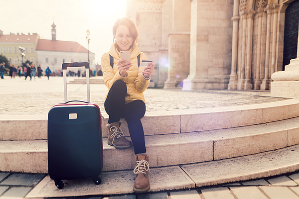 Woman Traveling In Europe And Using Credit Card For Hotel Reservation Photograph by Martin-dm