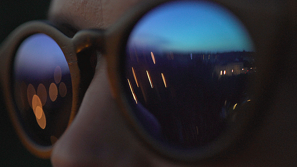 Woman wearing fashionable eyewear. City lights reflecting in glasses Photograph by Slavemotion