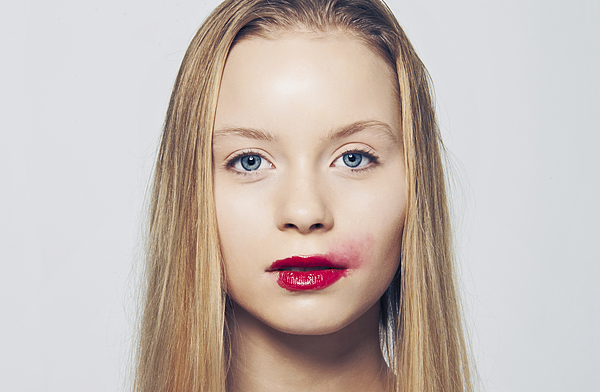 Woman with smeared lipstick Photograph by KMM Productions