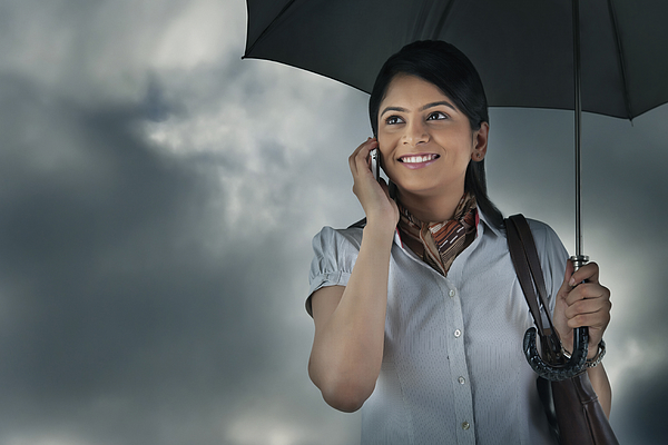Woman with umbrella talking on mobile phone Photograph by Abhinandita Mathur
