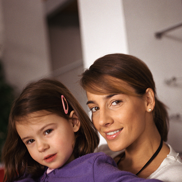 Woman with young girl, portrait, close-up Photograph by David Laurens