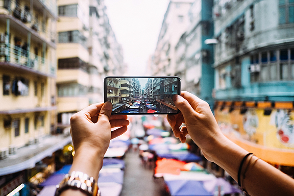 Womans Hand Taking A Photo Of Local City Street View In Hong Kong With Smartphone Photograph by D3sign