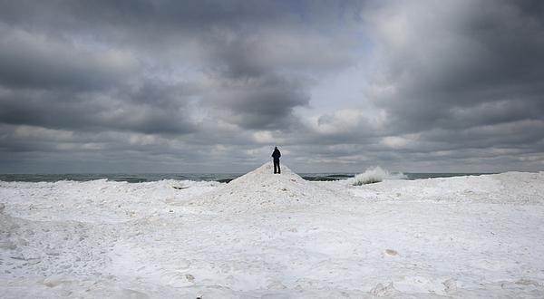 Women Standing On Frozen Lake Front Photograph by Jon Shireman