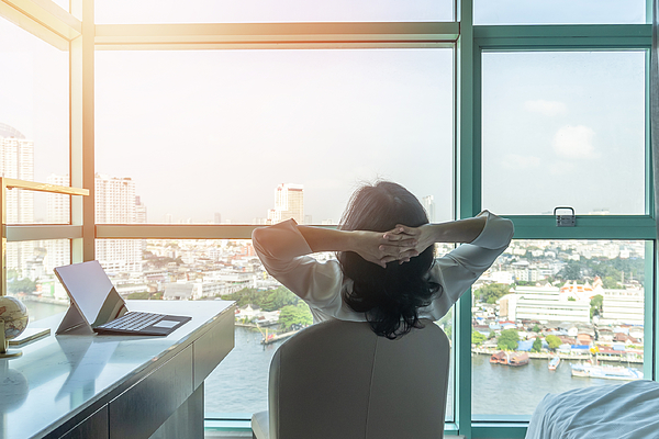 Work-life balance relaxation with Asian working business woman healthy lifestyle take it easy resting in comfort hotel or home living room having free time with peace of mind and self health balance Photograph by Chinnapong
