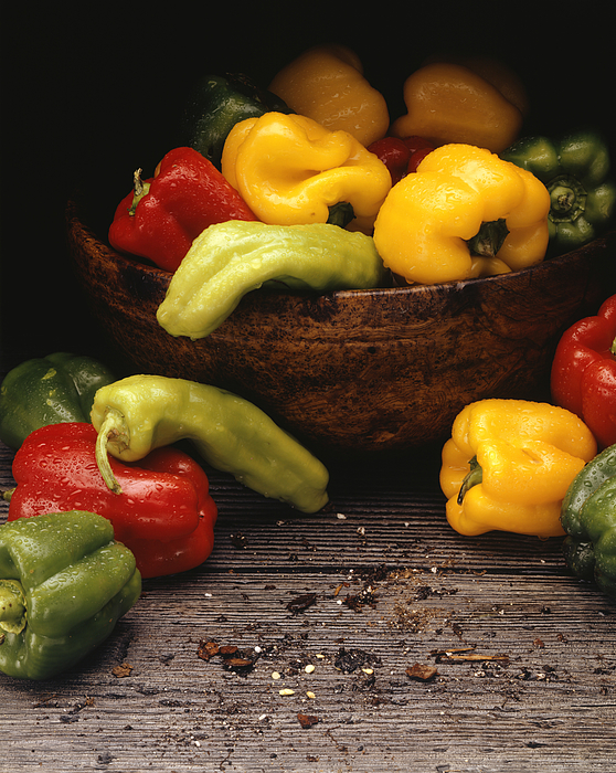 Yellow, red and green peppers in bowl, (Close-up) Photograph by Paul Katz