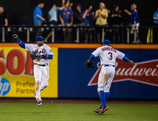 Yoenis Cespedes and Curtis Granderson Photograph by Rob Tringali/Sportschrome