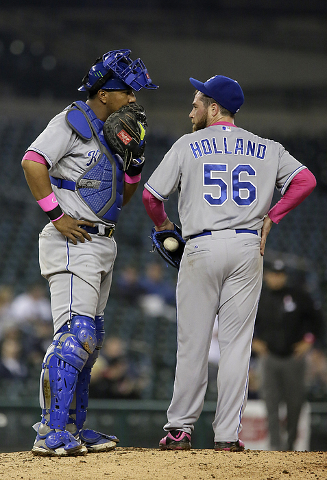Yoenis Cespedes and Greg Holland Photograph by Duane Burleson