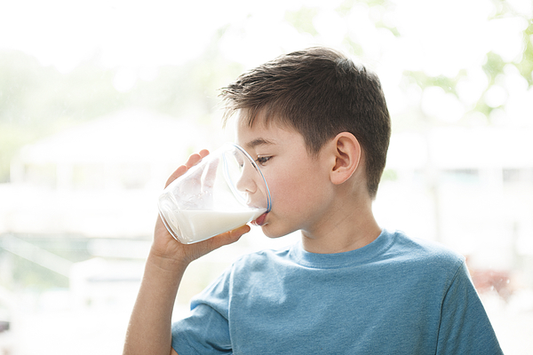 Young boy drinking milk Photograph by Chris Stein