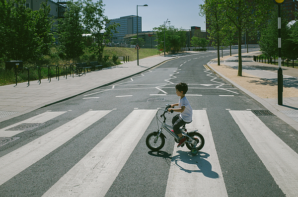 Young boy on bicycle Photograph by © Peter Lourenco
