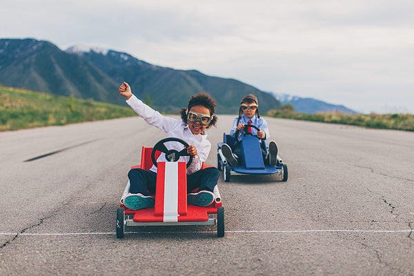 Young Business Girl Beats Boy In Car Race Photograph by RichVintage
