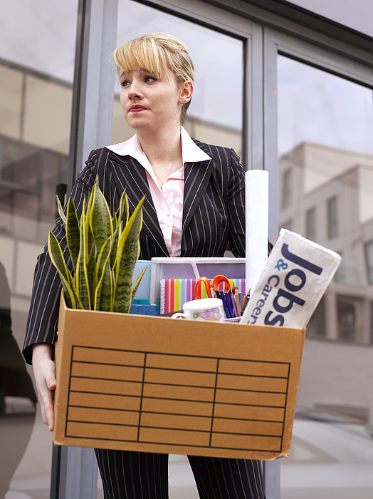 Young business woman made redundant  Photograph by Peter Dazeley
