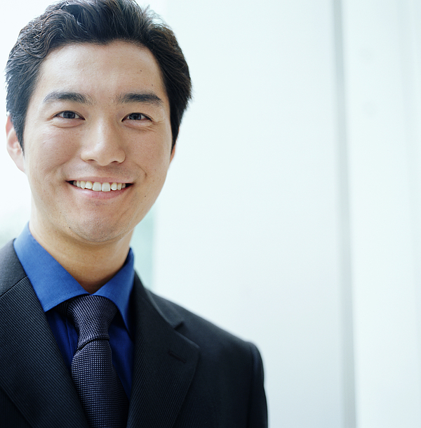 Young businessman smiling, close-up, portrait Photograph by Ryan McVay