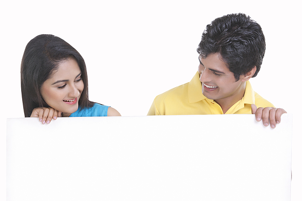 Young couple holding a board Photograph by Sudipta Halder