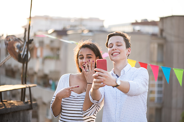 Young couple taking selfie of engagement ring Photograph by Emilija Manevska
