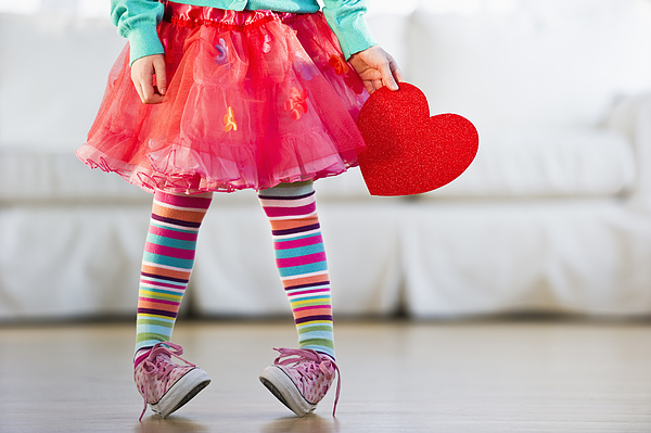 Young girl wearing colorful tights Photograph by Tetra Images - Daniel Grill