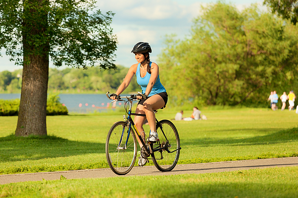 Young Healthy Woman Exercising on Bicycle in Urban City Photograph by YinYang