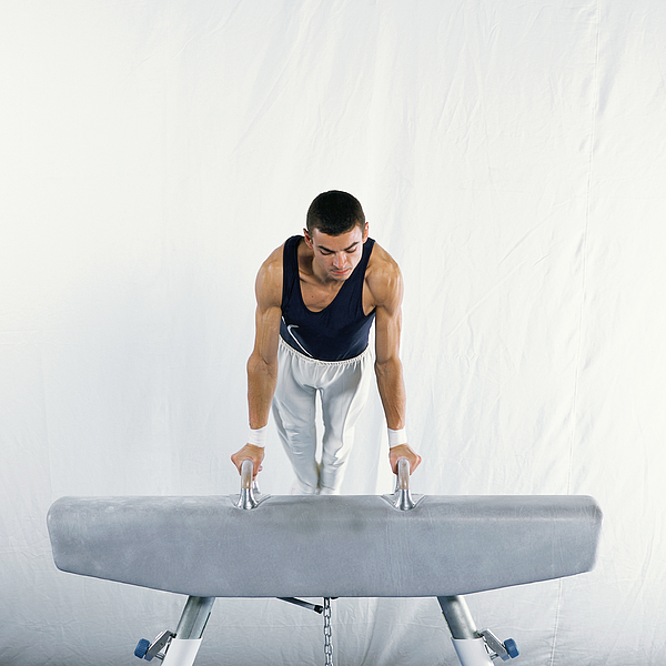 Young Male Gymnast Mounting Pommel Horse. Photograph by Dominique Douieb