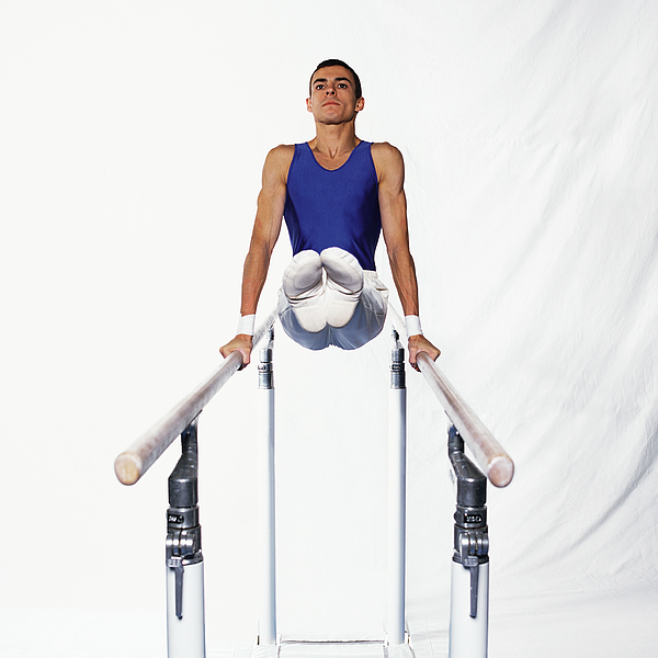 Young Male Gymnast On Parallel Bars, Side View. Photograph by Dominique Douieb