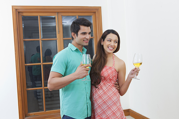 Young man and woman drinking wine Photograph by Ravi Ranjan