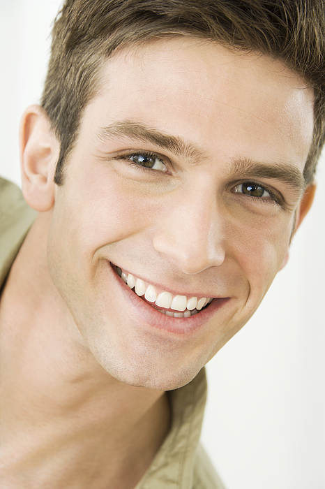 Young man smiling, portrait Photograph by Pando Hall