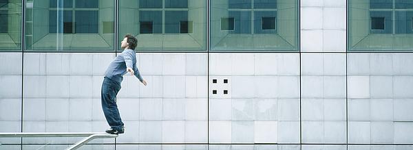 Young Man Standing On Rail Photograph by Matthieu Spohn