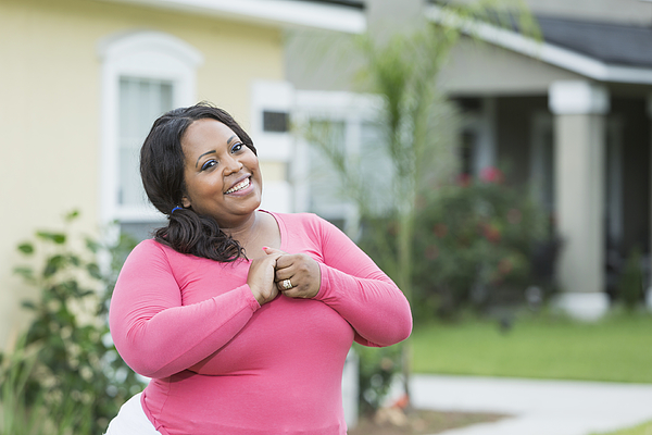 Young, Plus Size African American Woman Outside House Photograph by Kali9