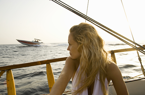 Young Woman On A Sailing Boat Photograph by Kathrin Ziegler