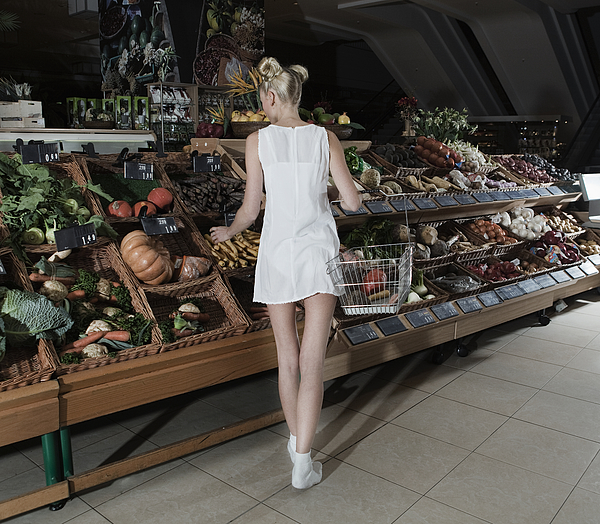 Young Woman Shopping Vegetables In Mall Photograph by Frank Rothe