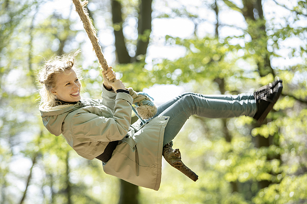 Young Woman Swinging In The Forest Photograph by Bo Tornvig
