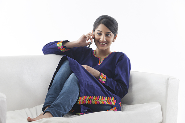 Young woman talking on her cell phone Photograph by Hemant Mehta